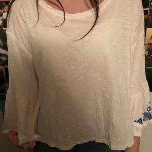 Long sleeve, light, floral shirt.